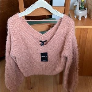 Cropped over sized V- neck sweater